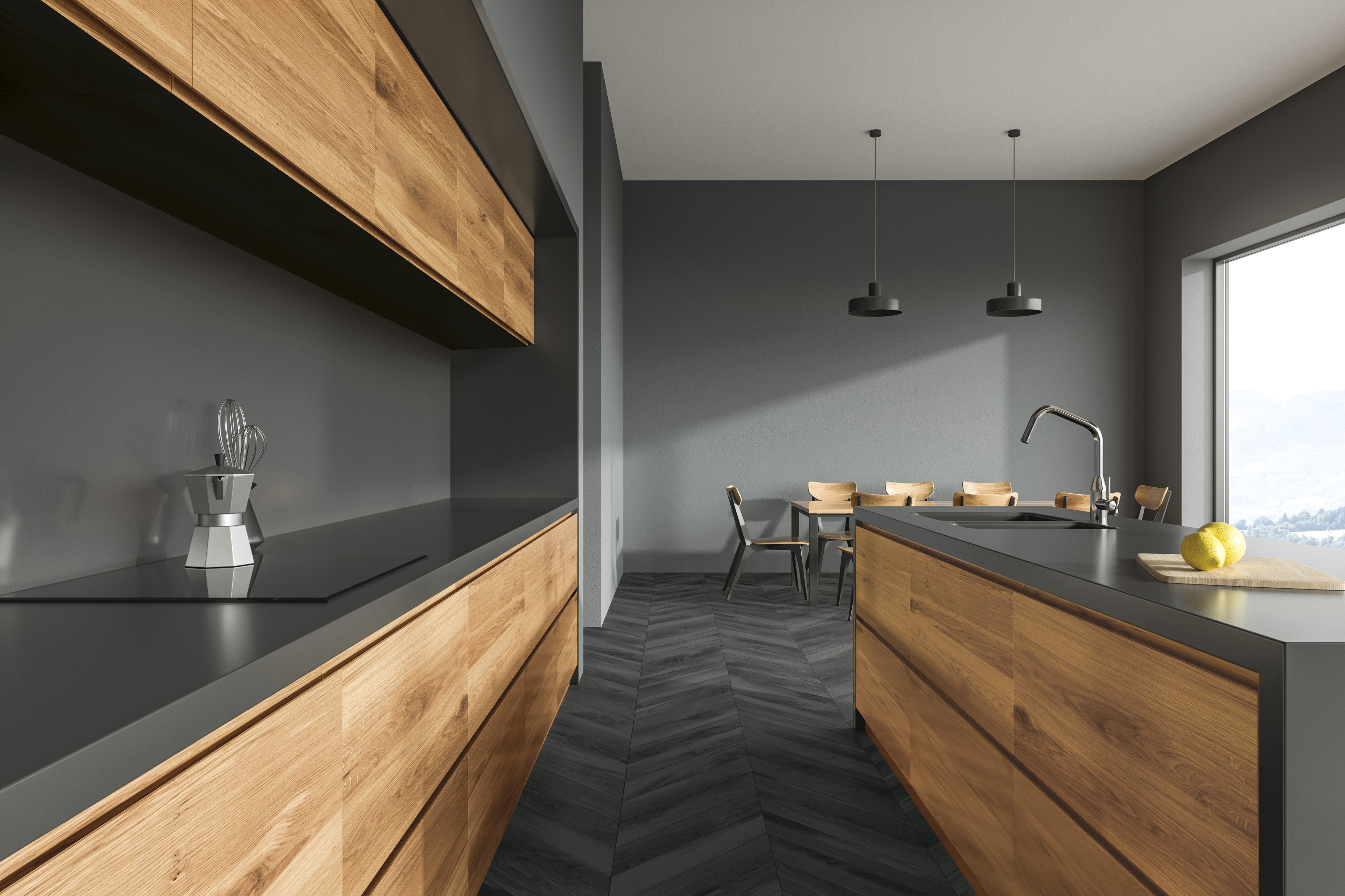 Wooden floor kitchen interior with wooden and gray countertops and a long table standing in the background. Close up 3d rendering mock up
